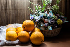 Beautiful flower bouquet and fresh Oranges Stock Photos