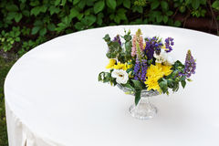Beautiful flower bouquet outdoors. Wedding floristic decoration at white table Royalty Free Stock Images