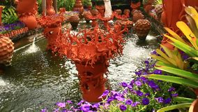 Beautiful flower garden with ceramic fountains. The beautiful flower garden with ceramic fountains stock video