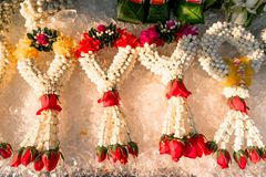 Beautiful flower garland made of jasmine, rose, marigold, crown flowers and green leaves put on ice for longer freshness mostly fo. Und in flower market.nn stock photo