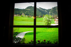 Beautiful flower and green garden though the window  in scenic place, Austria Stock Photos