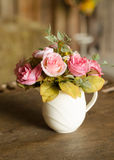 Beautiful flower in pot retro decoration on table Royalty Free Stock Image