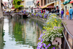 Beautiful flower pots along the canals in Annecy, France, known Royalty Free Stock Image