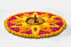 Beautiful Flower rangoli or decoration with clay lamp for diwali or any indian festival. Flower rangoli for Diwali or pongal made using marigold or zendu flowers Royalty Free Stock Photography