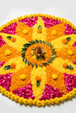 Beautiful Flower rangoli or decoration with clay lamp for diwali or any indian festival. Flower rangoli for Diwali or pongal made using marigold or zendu flowers Stock Photo