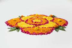 Beautiful Flower rangoli or decoration with clay lamp for diwali or any indian festival. Flower rangoli for Diwali or pongal made using marigold or zendu flowers Stock Photos