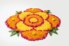 Beautiful Flower rangoli or decoration with clay lamp for diwali or any indian festival. Flower rangoli for Diwali or pongal made using marigold or zendu flowers Stock Images