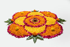 Beautiful Flower rangoli or decoration with clay lamp for diwali or any indian festival. Flower rangoli for Diwali or pongal made using marigold or zendu flowers Royalty Free Stock Photos