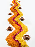 Beautiful Flower rangoli or decoration with clay lamp for diwali or any indian festival. Flower rangoli for Diwali or pongal made using marigold or zendu flowers Royalty Free Stock Images