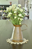 Beautiful flower in vintage vase on the table Stock Photography