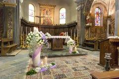 Beautiful flower wedding decoration in a church. During catholic wedding ceremony Stock Photo