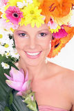 Beautiful with flowers. Young woman with flower hairstyle Royalty Free Stock Image