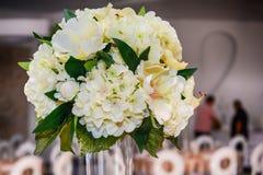 Beautiful flowers arranged on table stock photos