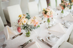 Beautiful flowers as dining table decoration Stock Photos