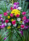 Beautiful flowers background for wedding scene. beautiful bouquet of mixed flowers in a vase on wooden table. The work of the florist at a flower shop. a stock photos