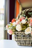 Beautiful flowers in basket on wooden table Royalty Free Stock Image
