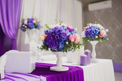 Beautiful flowers and candles on table in wedding Stock Images