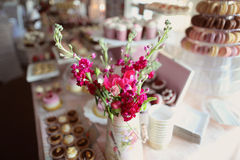 Beautiful flowers on candy bar Stock Photography