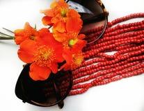 Beautiful flowers close-up orange color sunglasses Stock Photo
