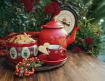 Autumn Cup of tea and cookies. Beautiful flowers and cup of tea with cookies at wooden table, autumn decor stock image