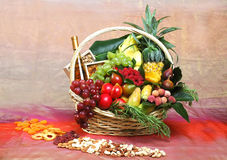 Beautiful flowers and fruits in A basket Royalty Free Stock Photo