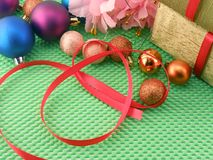 Beautiful flowers, gifts and Christmas ball Royalty Free Stock Photos