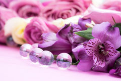 Beautiful flowers and glass ball Stock Photos