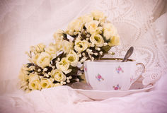 Beautiful flowers in a glass teacup Royalty Free Stock Photos