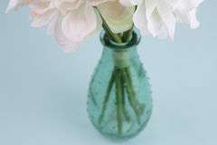 Beautiful flowers in a green vase Royalty Free Stock Image