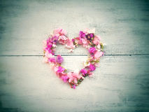 Beautiful flowers heart shape for valentine on wood background Royalty Free Stock Images
