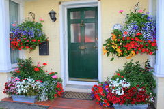 Beautiful flowers house entrance Stock Photos