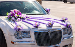 Beautiful flowers lay on the hood of wedding car. ST.PETERSBURG, RUSSIA - AUGUST 7, 2015: Beautiful flowers lay on the hood of wedding car Royalty Free Stock Photo