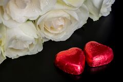 Free Beautiful Flowers On Black Background With Cream Roses Bouquet And Chocolates Red Heart Shaped Stock Images - 171813304