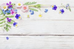 Free Beautiful Flowers On Wooden Background Stock Image - 148536181