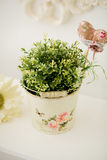 Beautiful flowers in pail on table Stock Photo