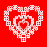 Beautiful flowers in the shape of a heart on a red Stock Photography