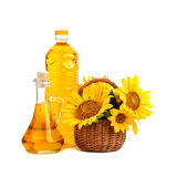Beautiful flowers of sunflowers in a rustic basket and sunflower oil on a white background. Stock Photo