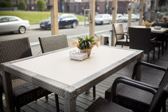 Beautiful flowers on table in the cafe. Fine Free cafe Table Setting With Bouquet Stock Images