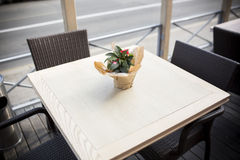 Beautiful flowers on table in the cafe. Fine Free cafe Table Setting With Bouquet Royalty Free Stock Image