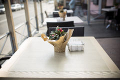 Beautiful flowers on table in the cafe. Fine Free cafe Table Setting With Bouquet Stock Image