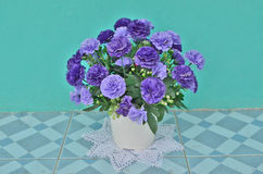 Beautiful flowers and vase. Beautiful artificial flowers in white vase Stock Image