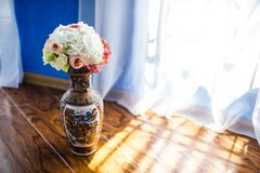 Beautiful flowers in vase with light from window. Wedding bouquet.  Stock Photography