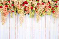 Beautiful flowers and wave curtain wall background - Wedding ceremony scene. stock photography