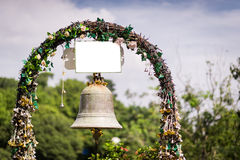 Beautiful flowers and wedding bell Stock Images