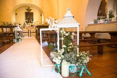 Wedding ceremony in the church. Beautiful flowers wedding decoration in a church, for the marriage Stock Photos