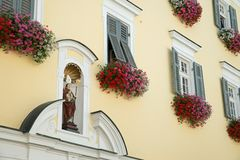 Beautiful flowers at window in sankt wolfgang austria royalty free stock photo