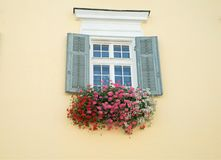 Beautiful flowers at window in sankt wolfgang austria royalty free stock photos