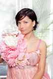 Beautiful flowers woman with spring pink dress. Portrait Stock Image