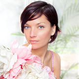 Beautiful flowers woman with spring pink dress. Portrait Royalty Free Stock Image