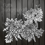 Beautiful flowers on a wooden texture. Stock Photo